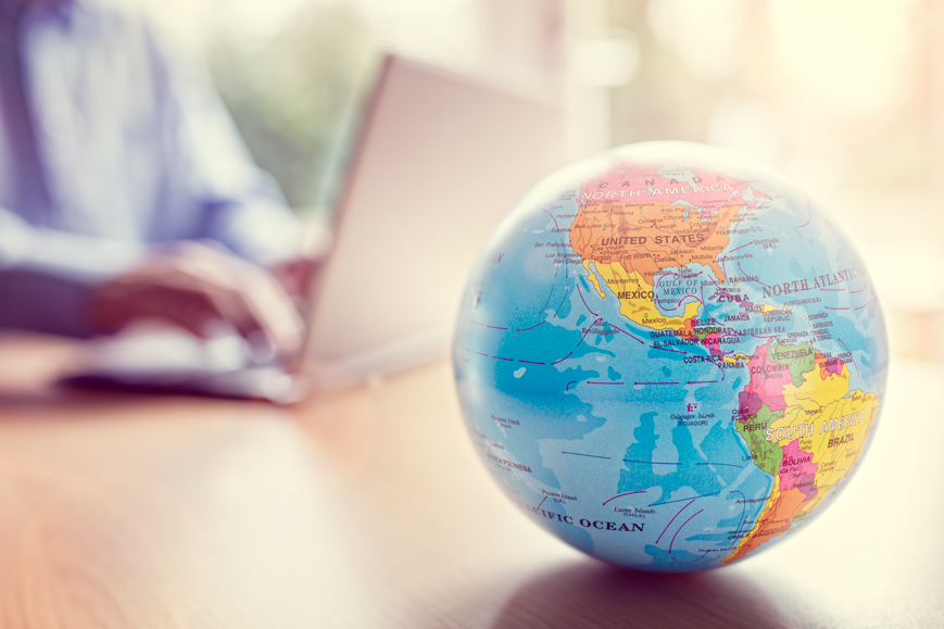 Localisation of content - globe by laptop