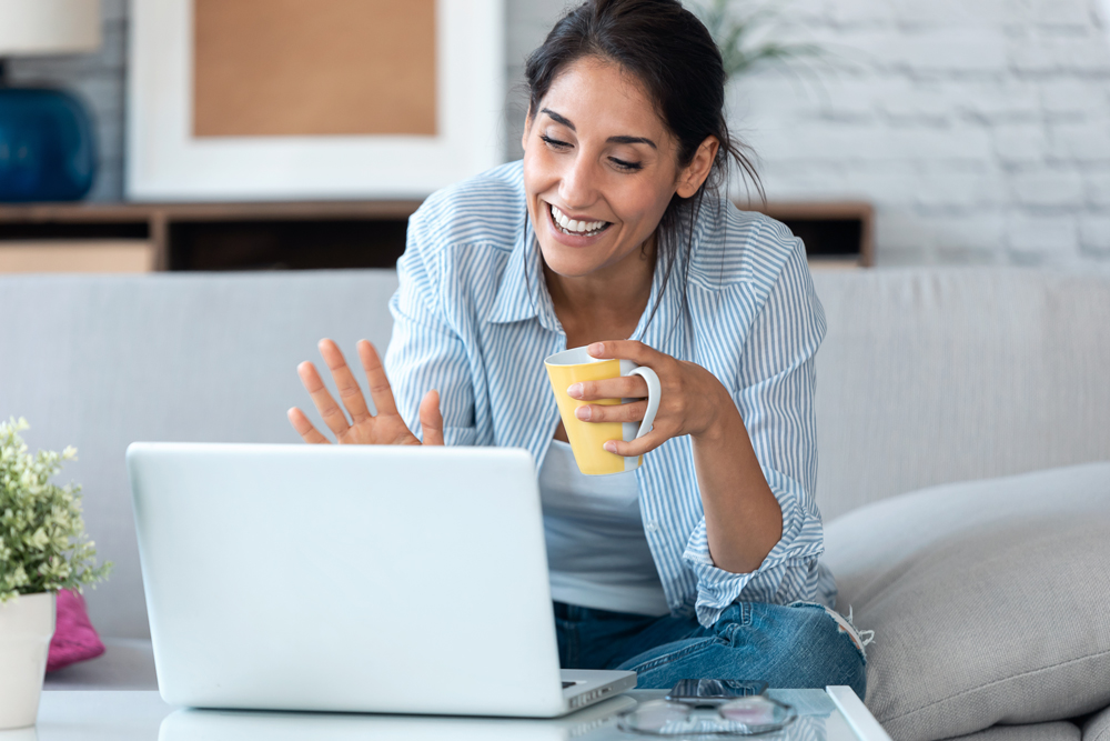 onboarding online - woman waving at laptop