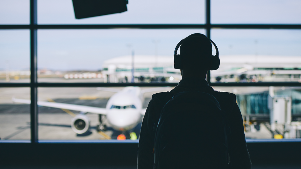 Displays podcast listener at airport