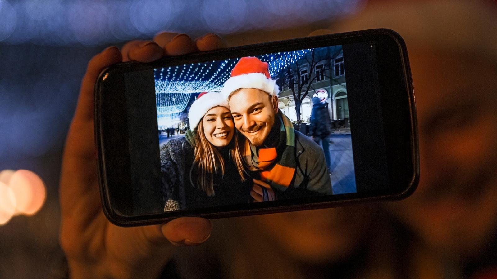 Couple having photo taken for seasonal content